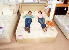 2 People testing a mattresses