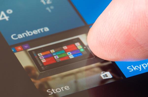 Person using their finger to navigate through a touchscreen menu.