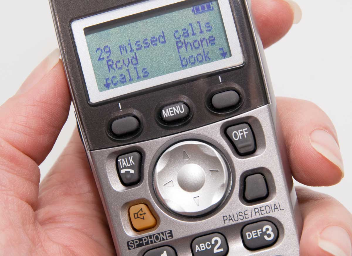 Photo of a cordless phone LCD screen.