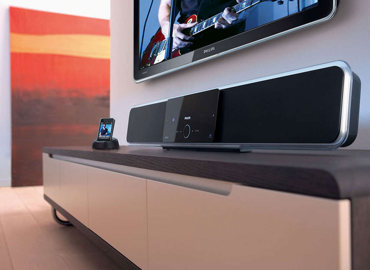 Photo of a sound bar with a media player built into it.