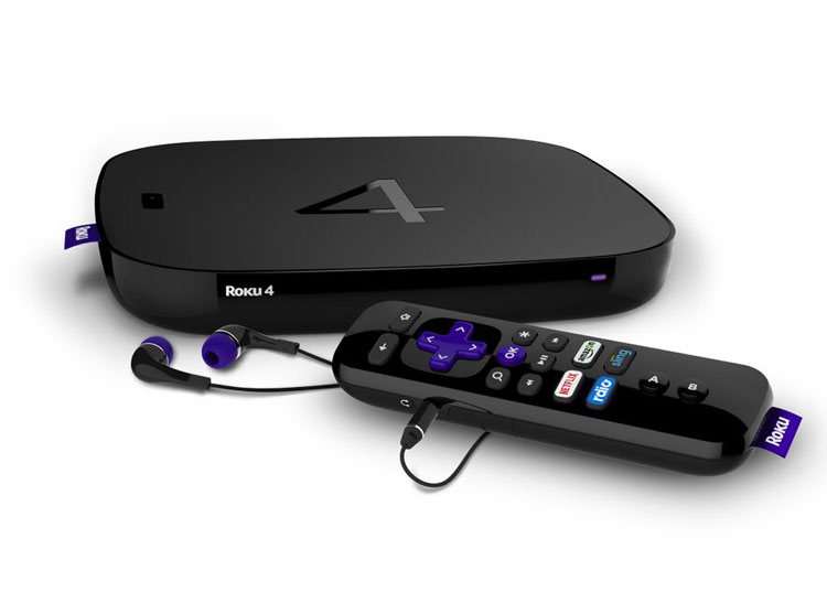 Picture of the Roku 4, plus the remote and included earbuds.