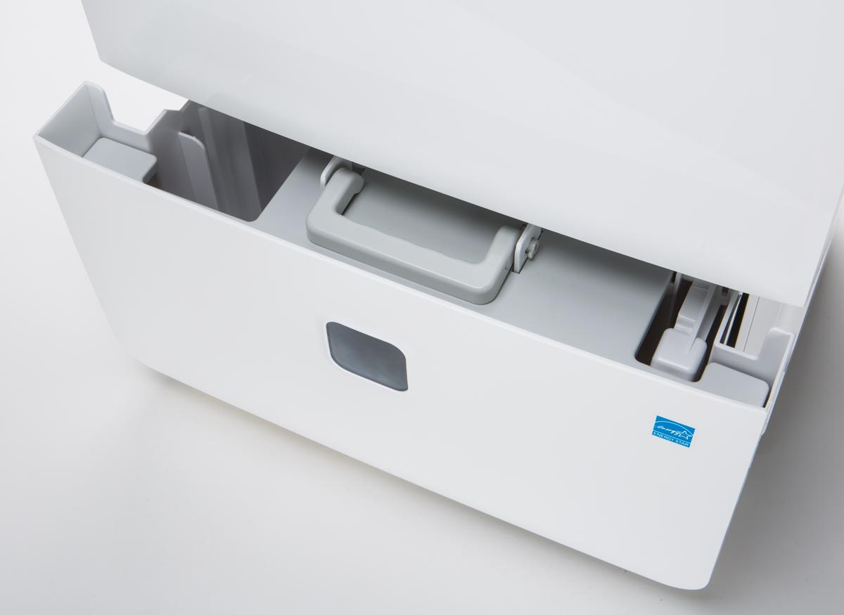 Photo of the removable tank on a dehumidifier that has a handle and a cover.
