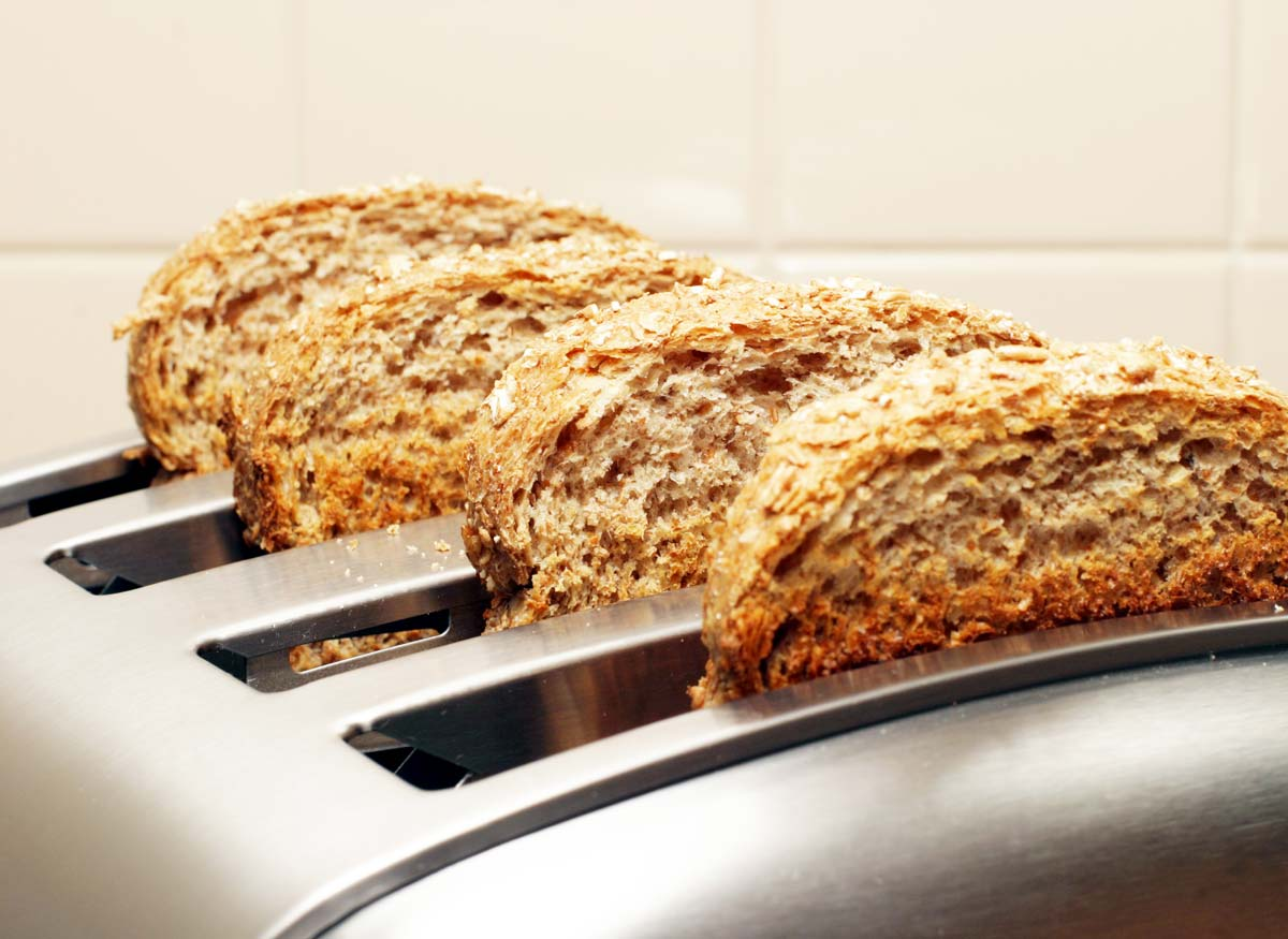 Photo of a toaster showign the slot size is big enough to fit large pieces of bread.