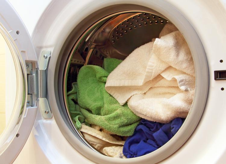 A washing machine full of towels.