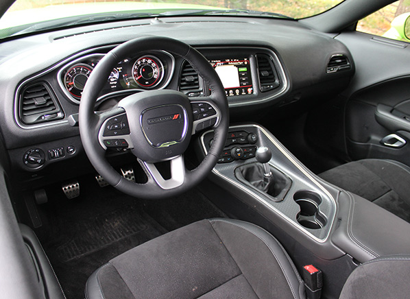 first drive freshened 2015 dodge challenger is a mean green cruising machine consumer reports. Black Bedroom Furniture Sets. Home Design Ideas