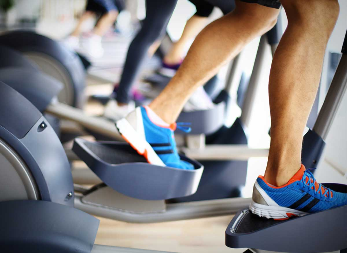Photo of a person on an elliptical trainer.