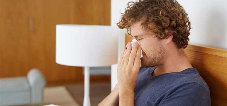 Fluoroquinolones. Image: Sick man blowing nose.