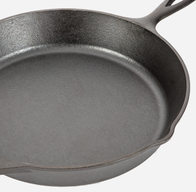 Photo of an uncoated cast iron pan.