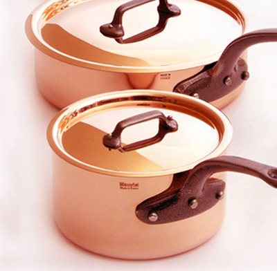 Photo of copper pans.