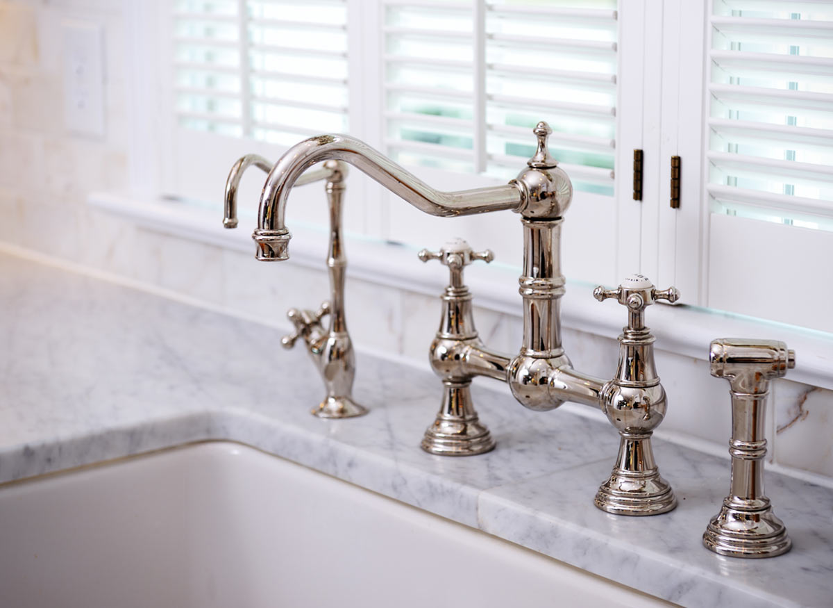 Photo of a shiny, clean faucet in a chrome finish.