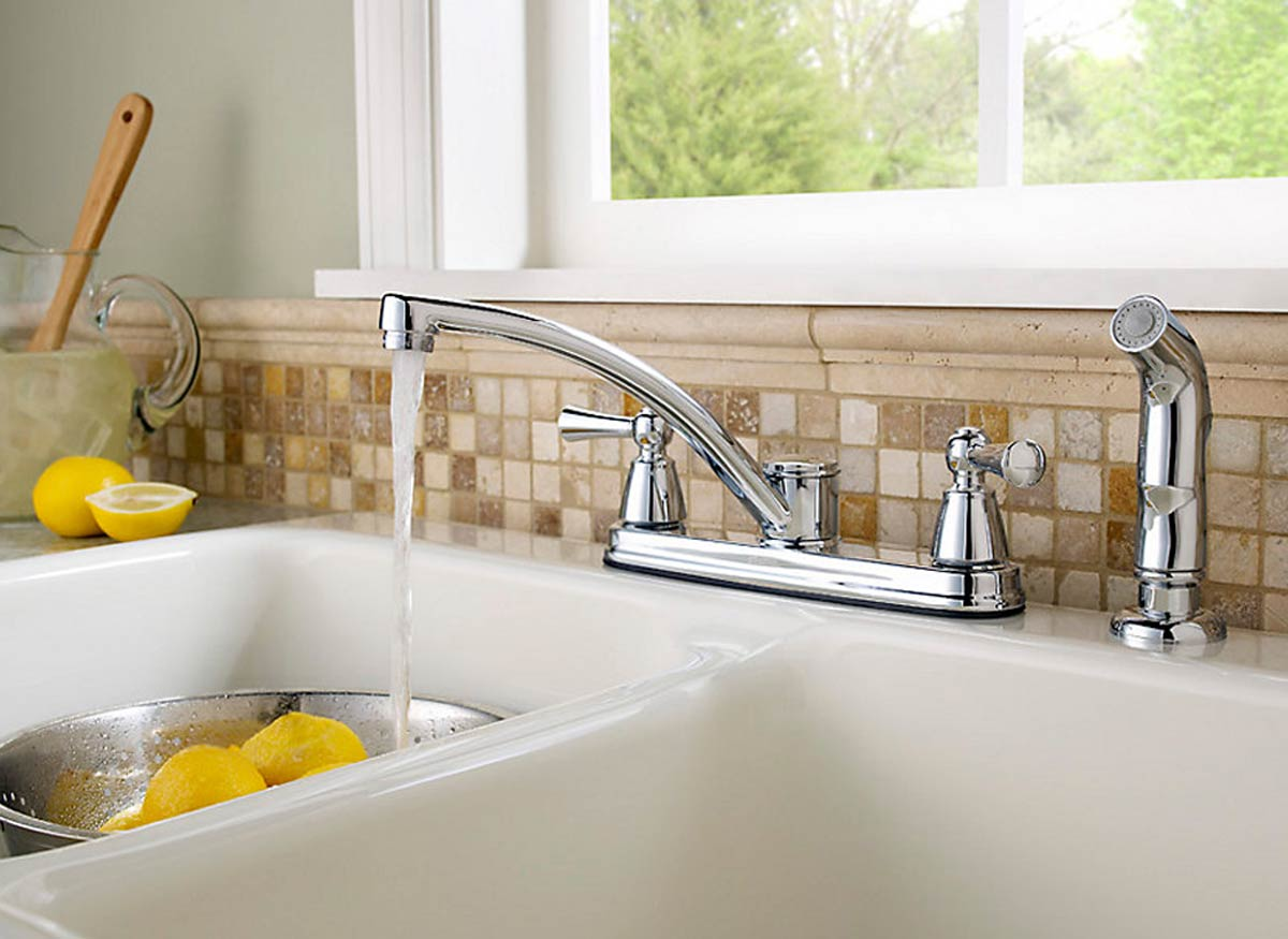 Photo of a kitchen faucet with a seperate side spray.