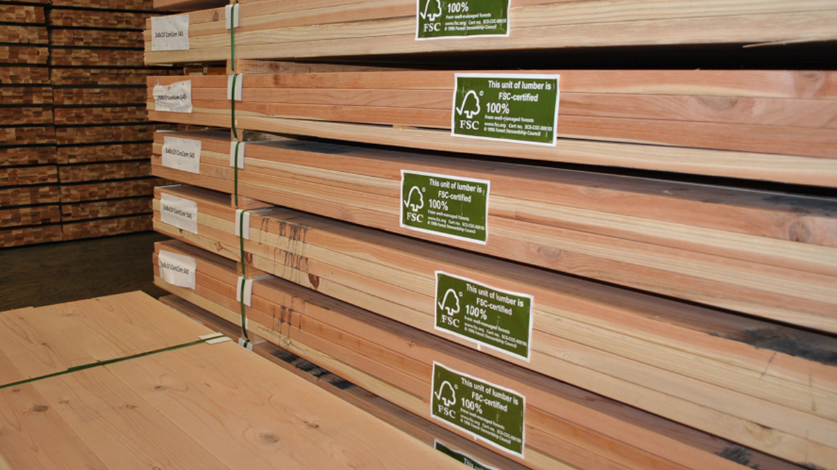 Pciture of stacks of flooring with the green and white FloorScore certification logo on each bundle of flooring.
