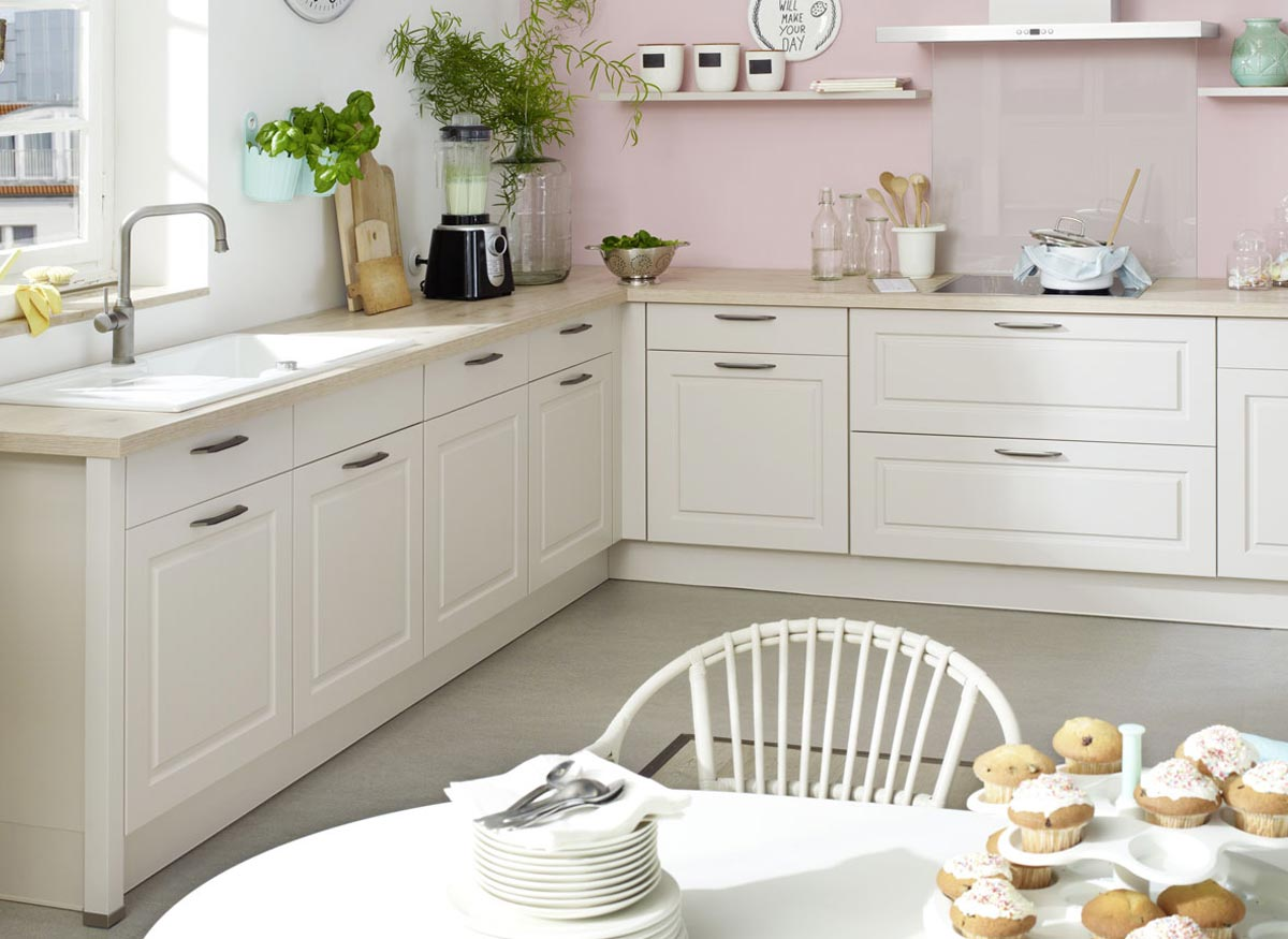 Photo of white kitchen cabinets that have a solid wood frame.