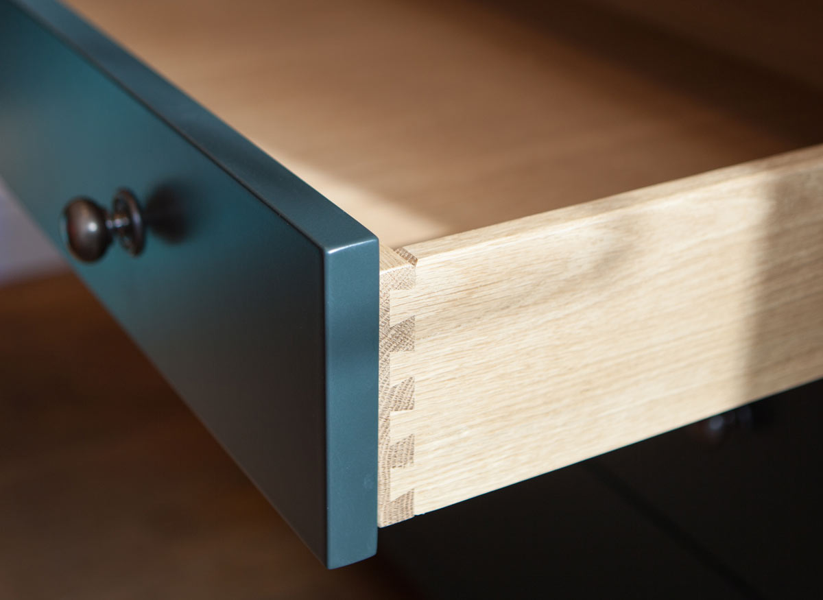 Photo of a kitchen cabinet drawer pulled out.