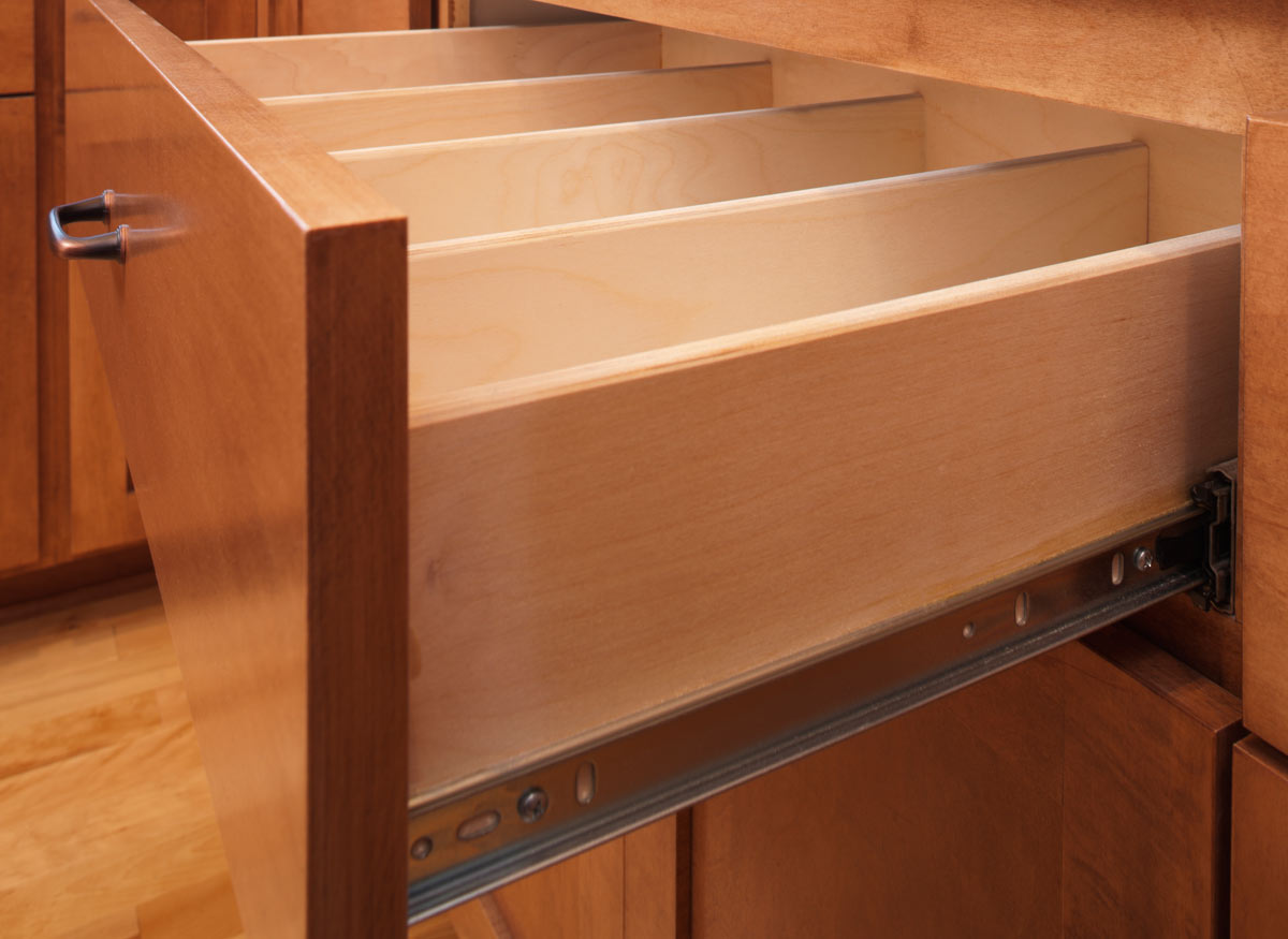 Photo of a kitchen cabinet drawer pulled out to show the full-extension guides.