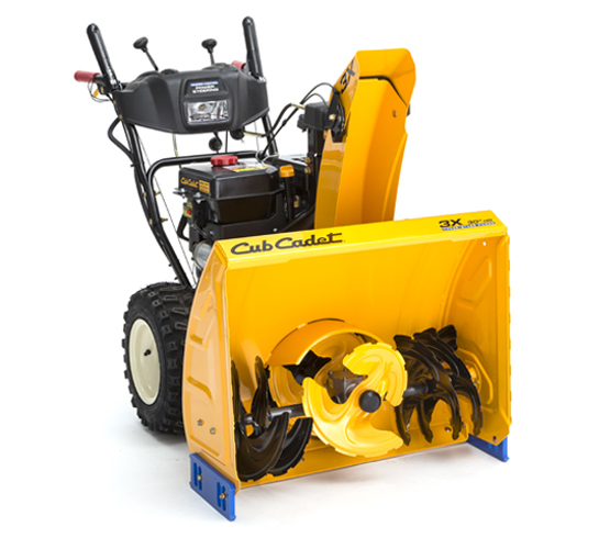 A bright yellow, two-stage gas snow blower.