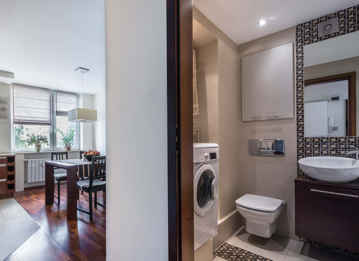 Photo of a bathroom built close to a dining room, in which case you may want a toilet that has a low noise level.