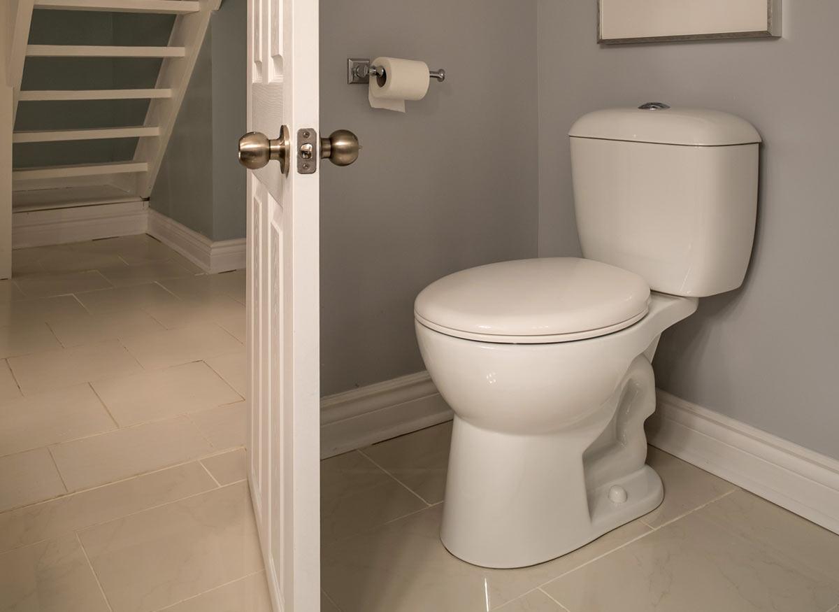 Photo of a toilet whith a round bowl.