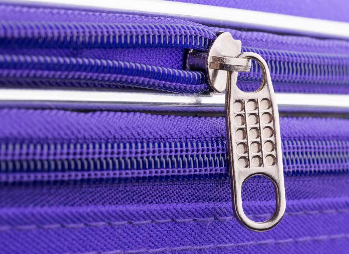 Photo of a suitcase zipper.