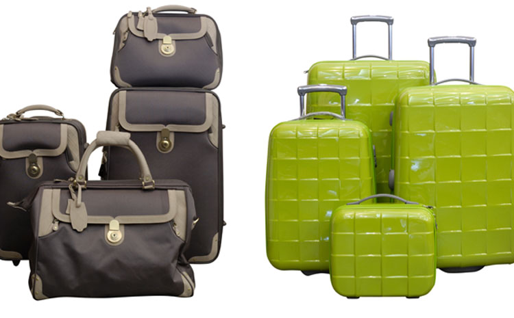 Photo of soft-sided luggage and hard sided luggage standing side by side.